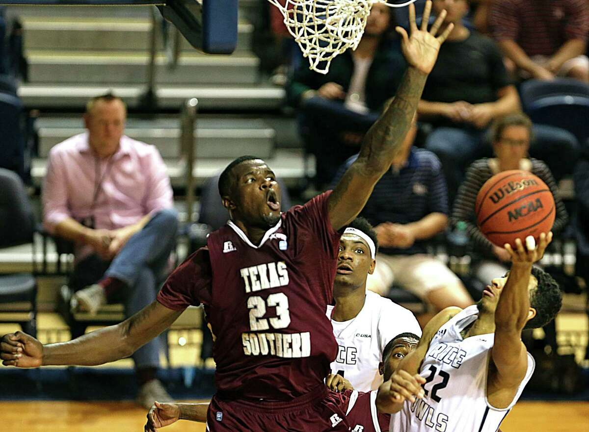 Texas Southern Tigers forward Derrick Griffin left, sets up to block Rice Owls guard Marcus Jackson right, during the first half of men's college basketball game action at Rice University's Tudor Fieldhouse Nov. 16, 2016, in Houston.