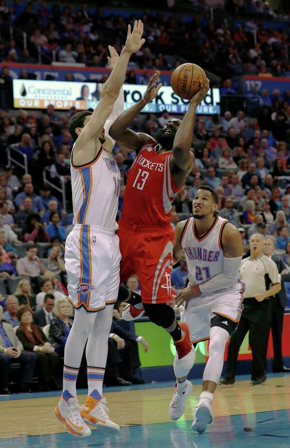 Houston Rockets guard James Harden (13) shoots as Oklahoma City Thunder center Enes Kanter (11) defends during the first half of an NBA basketball game in Oklahoma City, Wednesday, Nov. 16, 2016. (AP Photo/Alonzo Adams) Photo: Alonzo Adams, Associated Press / FR159426 AP