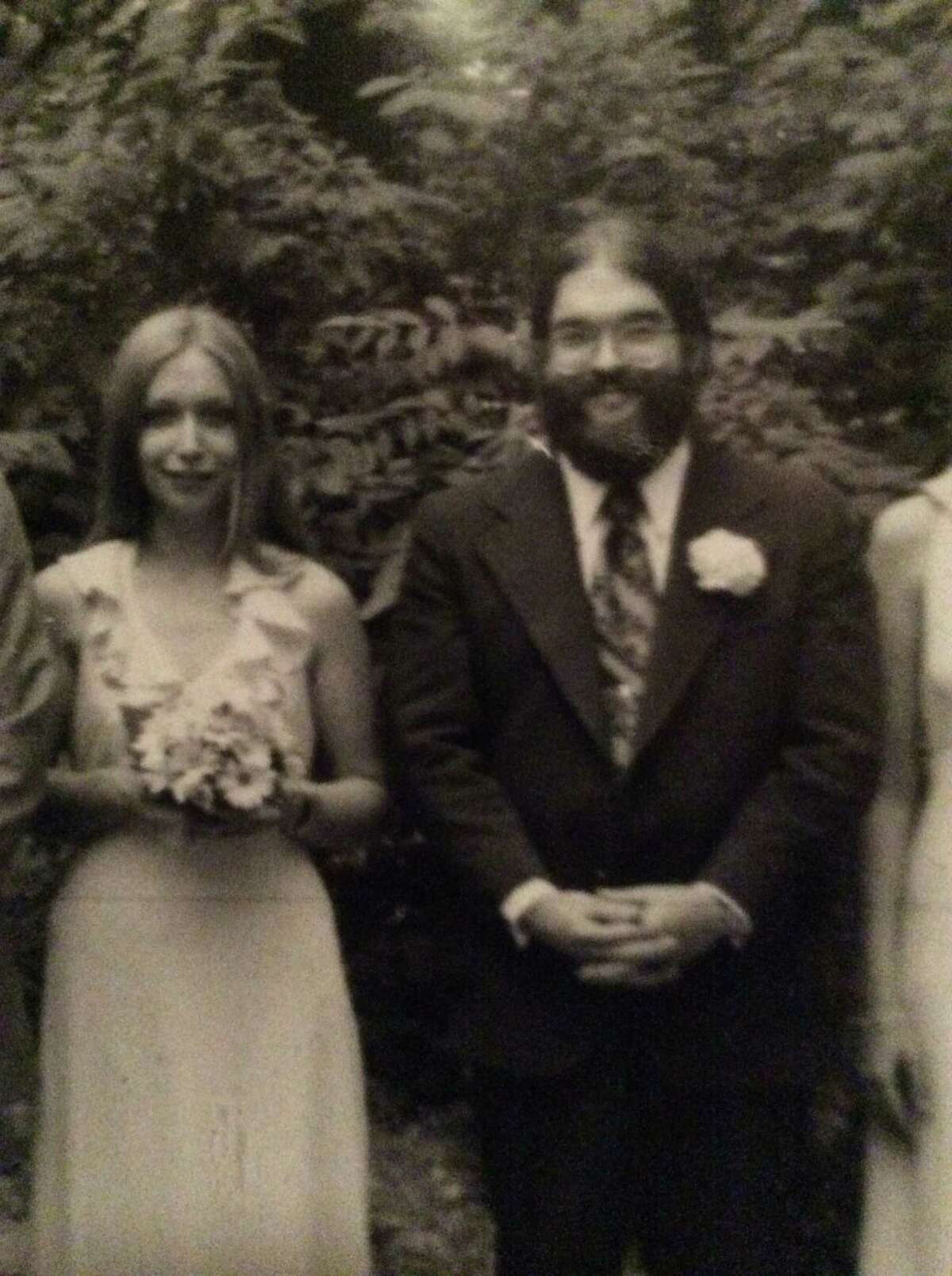 Lori Milks and her husband, Mike Milks, at the 1975 wedding of their friends Daniel and Judy Odell. (Courtesy the Odells)