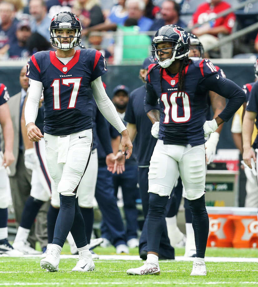 Texans quarterback Brock Osweiler, left, and receiver DeAndre Hopkins didn't click in their one season together. Photo: Brett Coomer, Staff / © 2016 Houston Chronicle