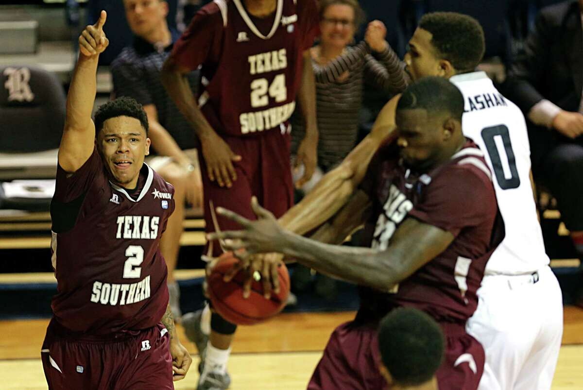 Texas Southern Tigers guard Zach Lofton left, points in the air as Texas Southern forward Derrick Griffin center, and Rice Owls guard Connor Cashaw right, wrestle fro control of a rebound during the second half of men's college basketball game action at Rice University's Tudor Fieldhouse Nov. 16, 2016, in Houston.