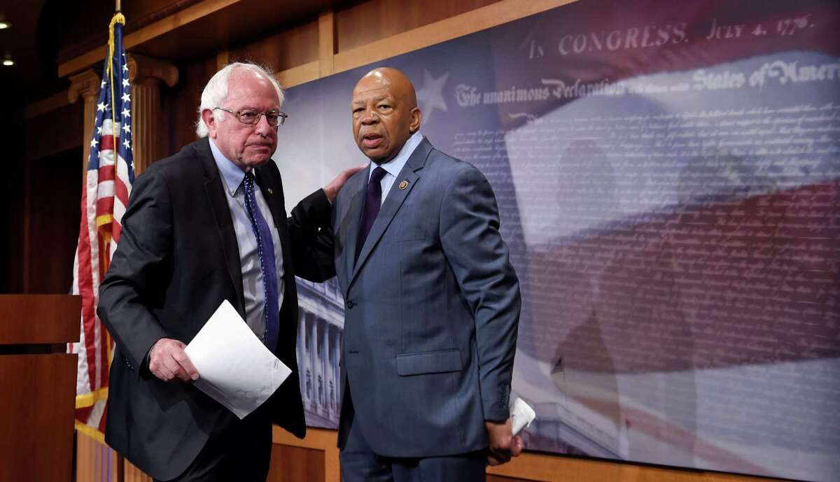 FILE - In this Sept. 10, 2015 file photo, Sen. Bernie Sanders, I-Vt., left, and Rep. Elijah Cummings, D-Md., leave a news conference on Capitol Hill in Washington. In November 2016, Cummings and Sanders unveiled a new strategy to try to control high drug prices. Rather than launching another congressional probe, the lawmakers called on the Department of Justice to investigate possible price collusions among manufacturers of insulin, which they say has seen industrywide price increases of more than 300 percent between 2002 and 2013. (AP Photo/Susan Walsh, File)
