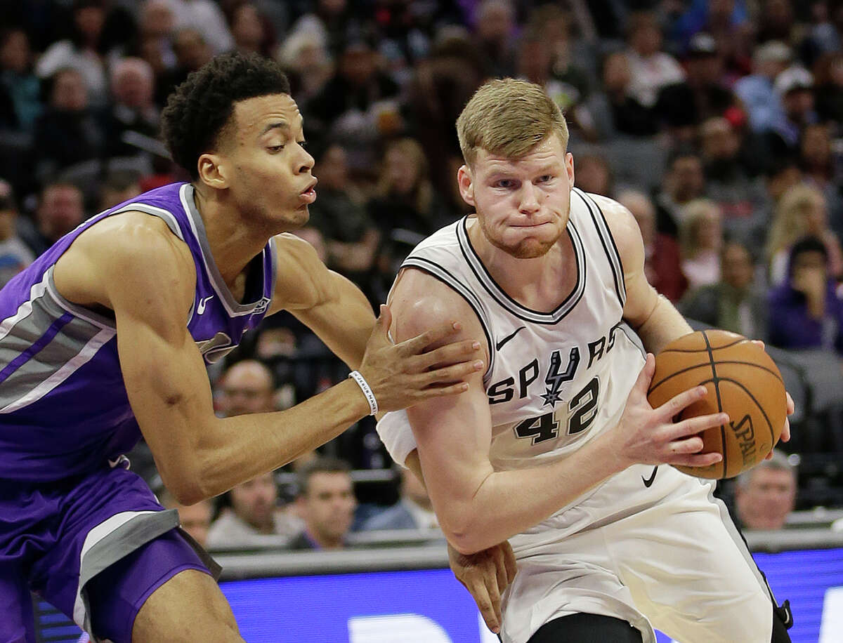 San Antonio Spurs forward Davis Bertans, right, drives to the basket against Sacramento Kings forward Skal Labissiere during the second half of an NBA basketball game Monday, Jan. 8, 2018, in Sacramento, Calif. The Spurs won 107-100. (AP Photo/Rich Pedroncelli)