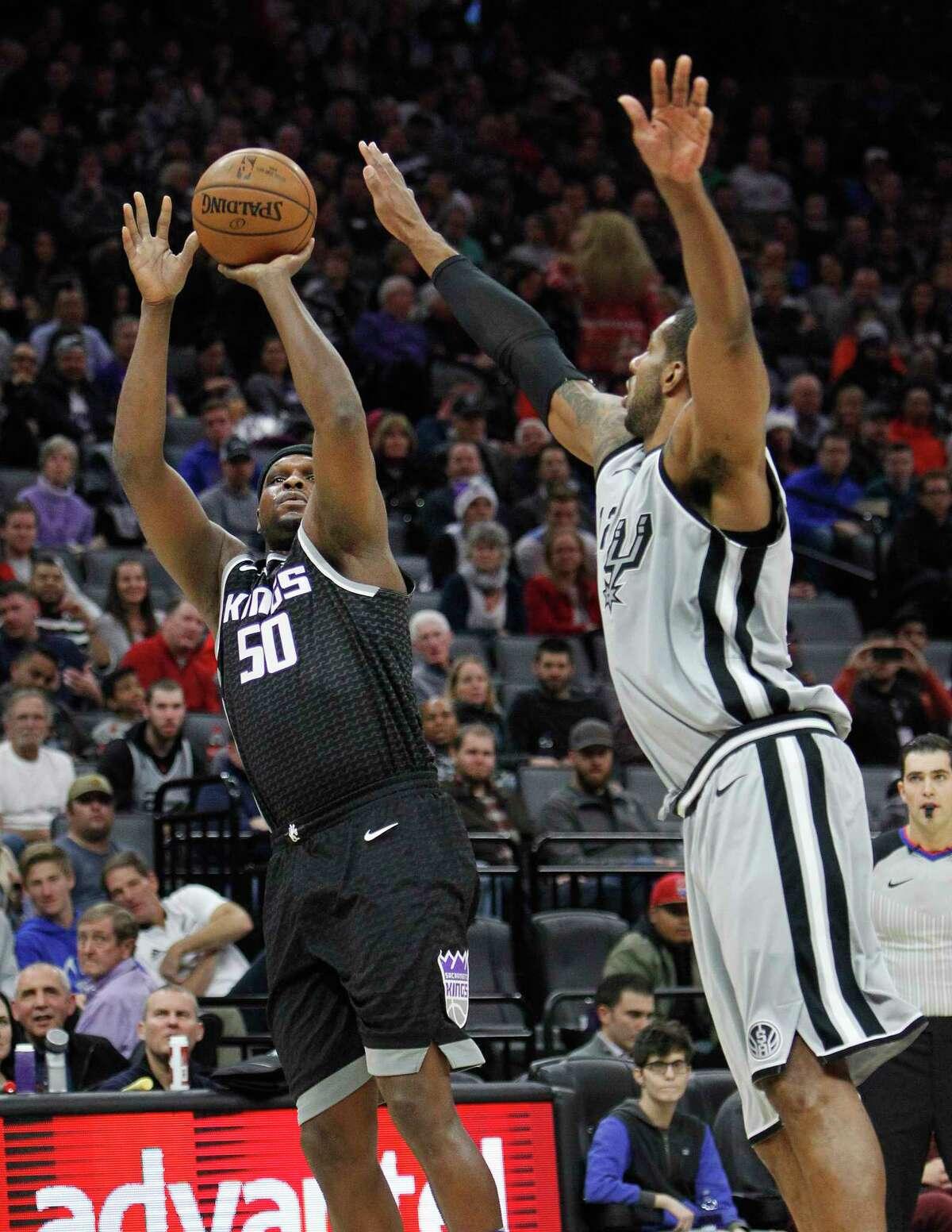 Sacramento Kings forward Zach Randolph (50) shoots over San Antonio Spurs' LaMarcus Aldridge during the first half of an NBA basketball game in Sacramento, Calif., Saturday, Dec 23, 2017. (AP Photo/Steve Yeater)