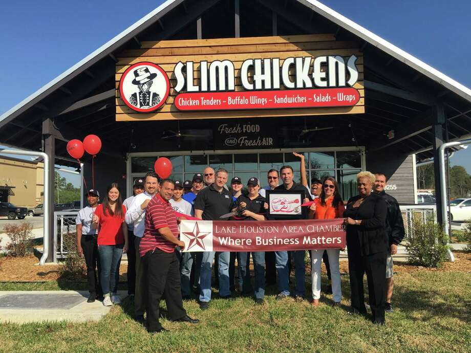 Slim Chickens personnel and members of the Lake Houston Area Chamber of Commerce perform a ribbon cutting ceremony outside the new Slim Chickens location in Humble Monday, Nov. 14. Photo: Courtesy Of The Lake Houston Area Chamber Of Commerce