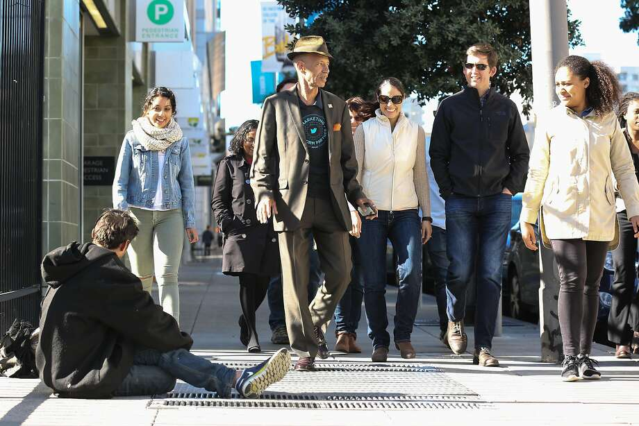 Del Seymour and a group of Adobe employees pass a homeless man while on the Tenderloin Walking Tour on Wednesday, November 16, 2016 in San Francisco, Calif. Photo: Amy Osborne, Special To The Chronicle