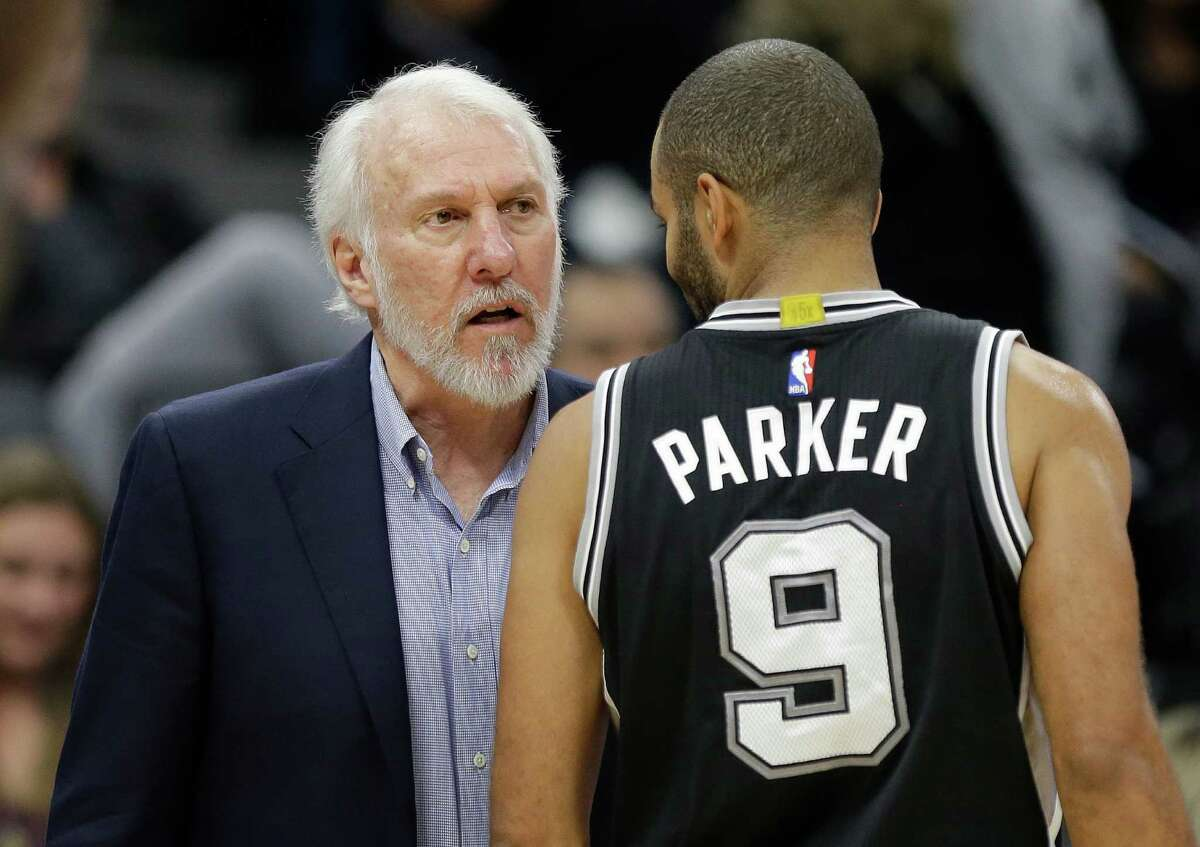 San Antonio Spurs coach Gregg Popovich talks with guard Tony Parker during the second half of the team's NBA basketball game against the Sacramento Kings in Sacramento, Calif., Wednesday, Nov. 16, 2016. The Spurs won 110-105. (AP Photo/Rich Pedroncelli)