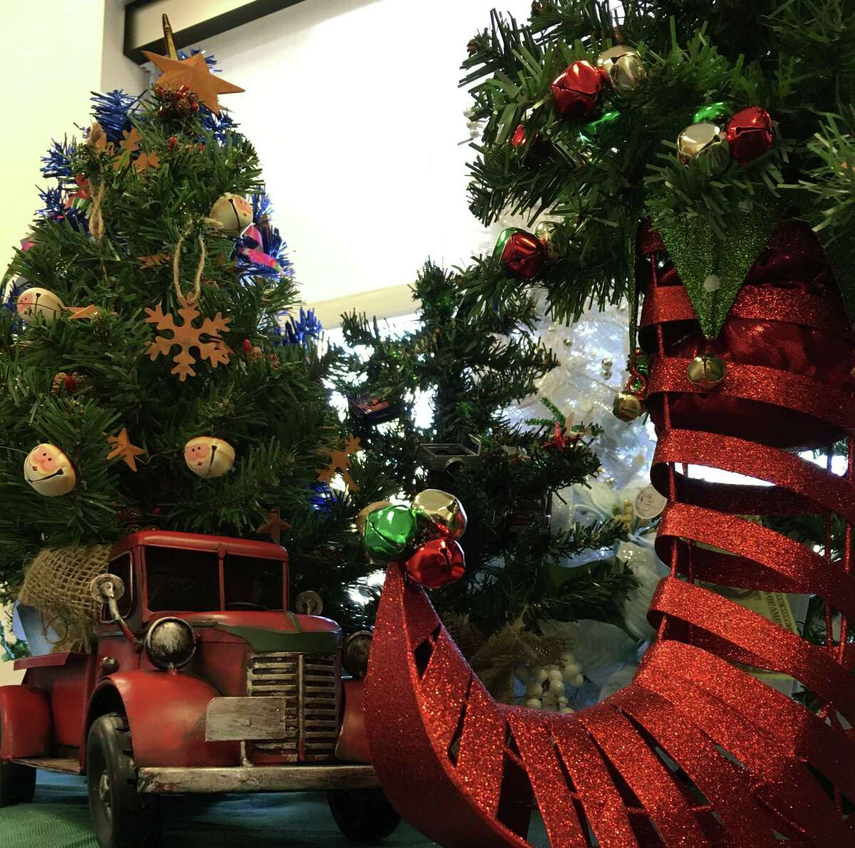Two of the winning trees from the 2015 Hope Forest tree decorating contest sit side by side at TriCare Hospice in Kingwood. TriCare Hospice invites the community to participate in the 2016 Hope Forest occurring from Nov. 30 through Dec. 6.