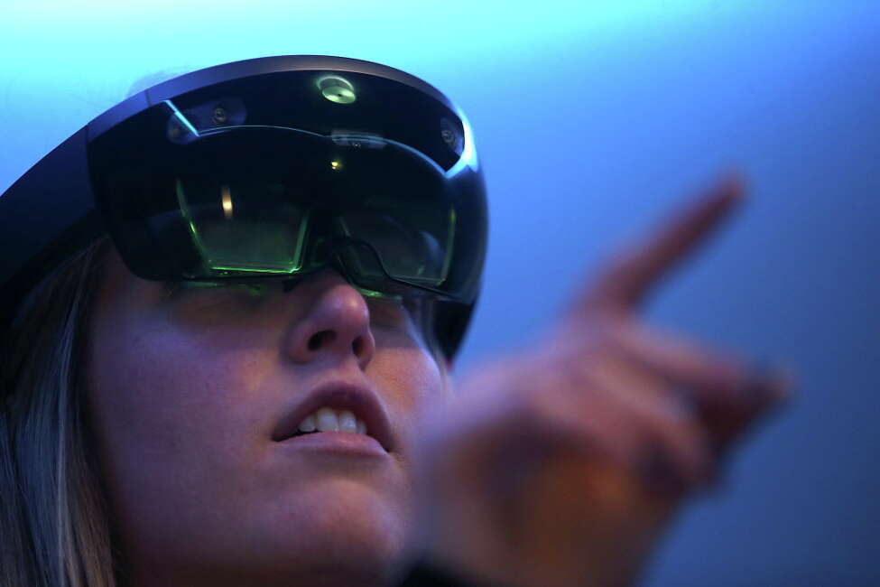 SAN FRANCISCO, CA - MARCH 30: Microsoft employee Gillian Pennington demonstrates the Microsoft HoloLens augmented reality (AR) viewer during the 2016 Microsoft Build Developer Conference on March 30, 2016 in San Francisco, California. The Microsoft Build Developer Conference runs through April 1. (Photo by Justin Sullivan/Getty Images) ORG XMIT: 623672187
