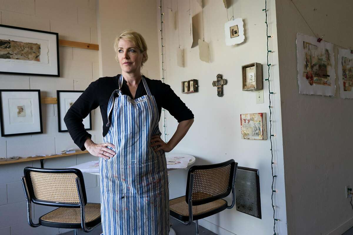 Holly Temple poses for a photograph at her studio she shares with her sister Ashlee in Sand City, Calif. on Friday, Nov. 11, 2016. Ortiz Street features a handful of artists studios.