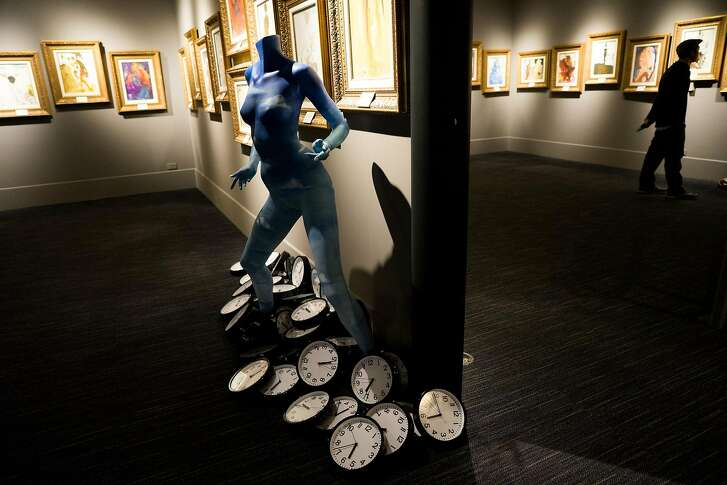 People look at works by Salvador Dali at Dali17 in Monterey, Calif. on Friday, Nov. 11, 2016. The museum highlights the time that Dali spent living in Monterey.