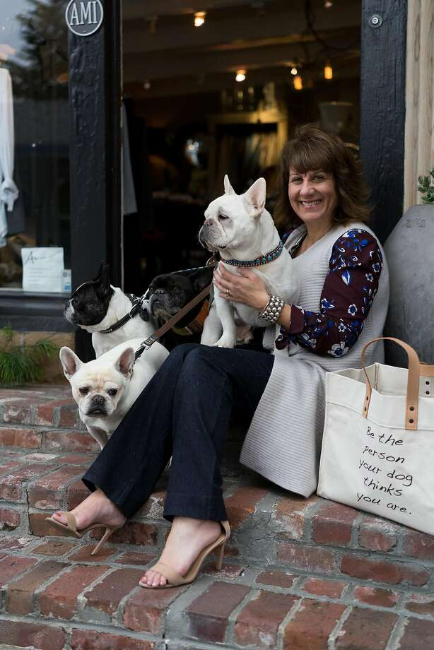 "Marci Bracco and her canine crew outside Ami, her go-to boutique in Carmel (Dolores Street between Fifth and Sixth avenues). ""It seems to have the best of everything."" Photo: James Tensuan, Special To The Chronicle"