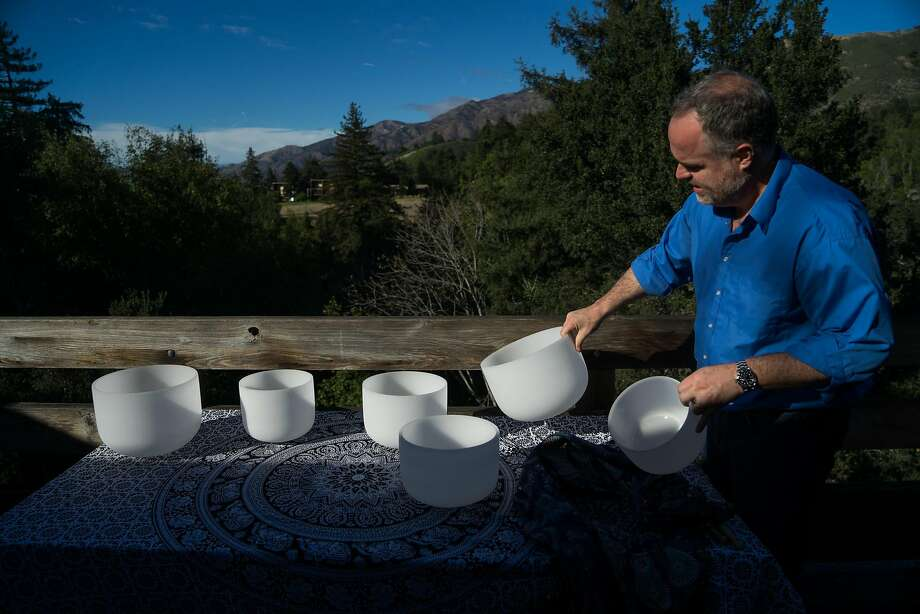 Alfonso Corono sets out quartz bowls to demonstrate cymatic resonance. One of the spiritual workshops offered at Ventana Big Sur. Photo: James Tensuan, Special To The Chronicle