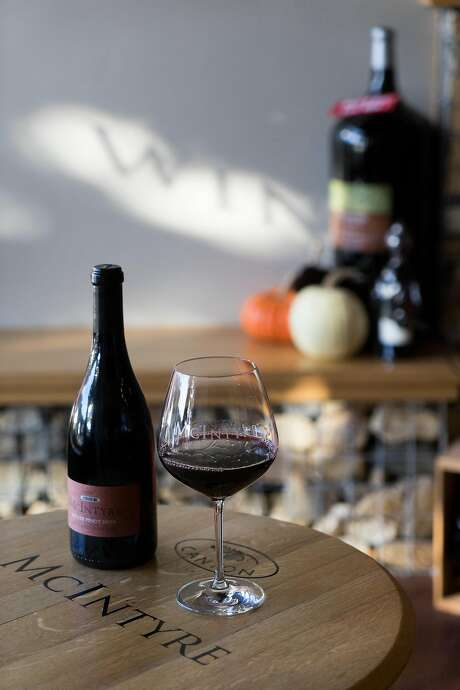 A glass of Pinot Noir at McIntyre Vineyards in Carmel; the tasting room offers a happy hour every Tuesday and Thursday. Photo: James Tensuan, Special To The Chronicle
