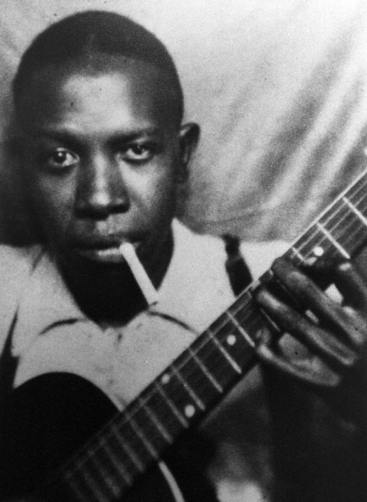 Blues guitarist and singer Robert Johnson, taken in the early 1930s.