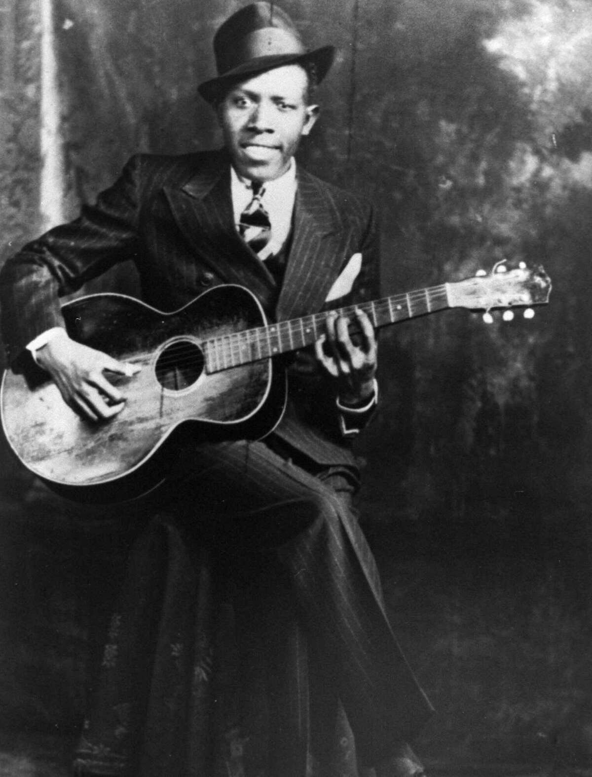 Blues guitarist and singer Robert Johnson in 1935 in Memphis, Tenn. This portrait taken in Memphis is one of only two photos of bluesman Robert Johnson known to exist.