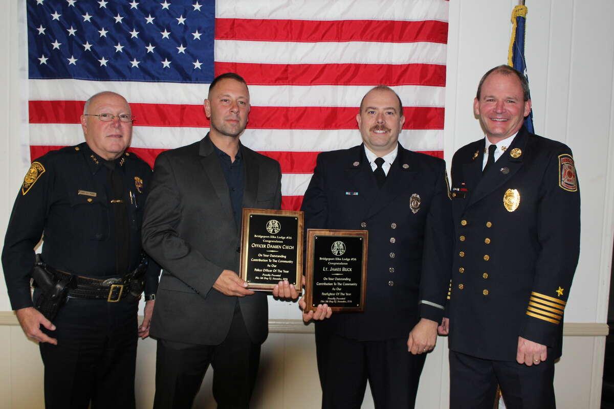 Bridgeport Police Chief A.J. Perez, Police Officer Damien Csech Bridgeport Fire Department Lt. James Buck, and Fire Chief Richard Thode.