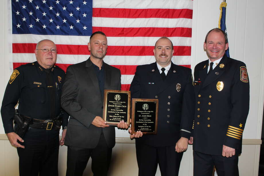 Bridgeport Police Chief A.J. Perez, Police Officer Damien Csech Bridgeport Fire Department Lt. James Buck, and Fire Chief Richard Thode. Photo: John Simko