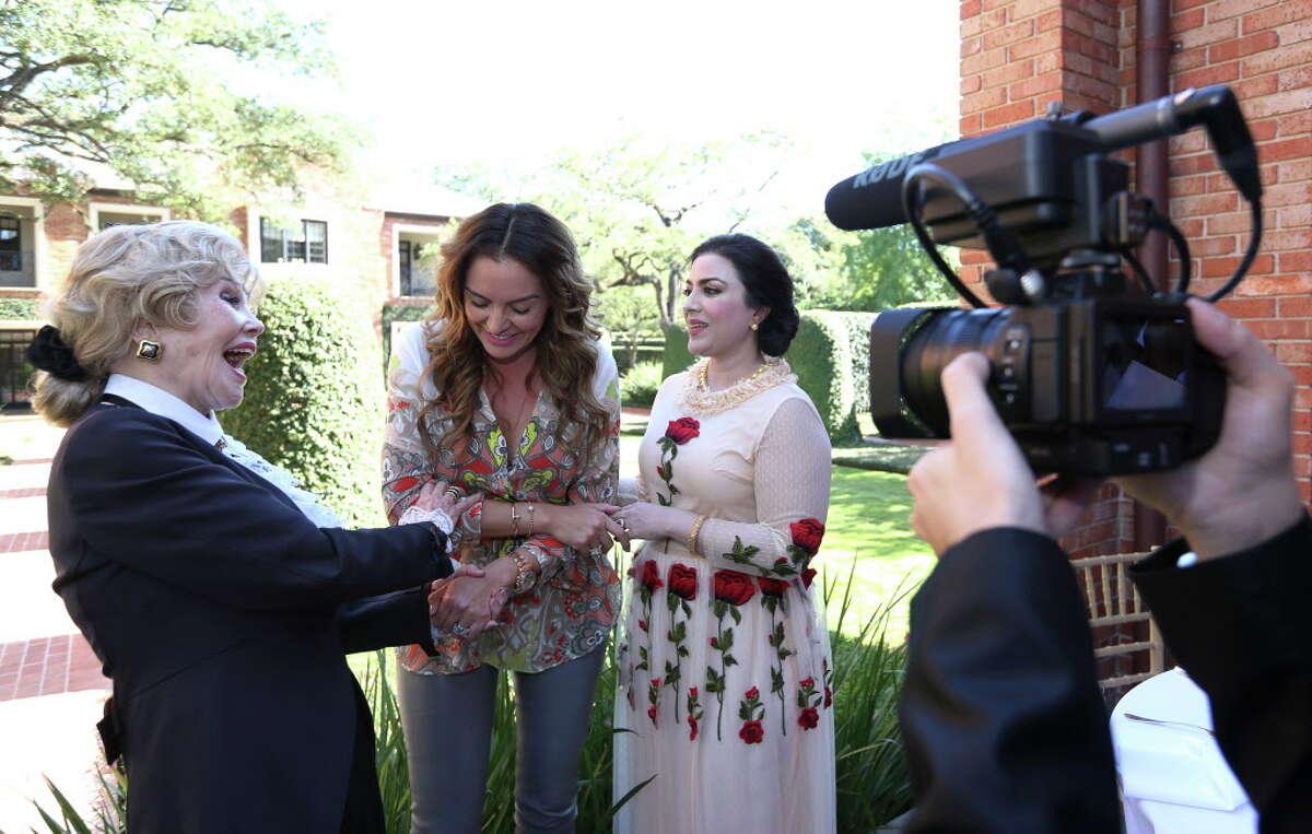 Joanne King Herring, left, Carmina Zamorano and Maha Kahn record a video clip at a kick-off party for Herring's