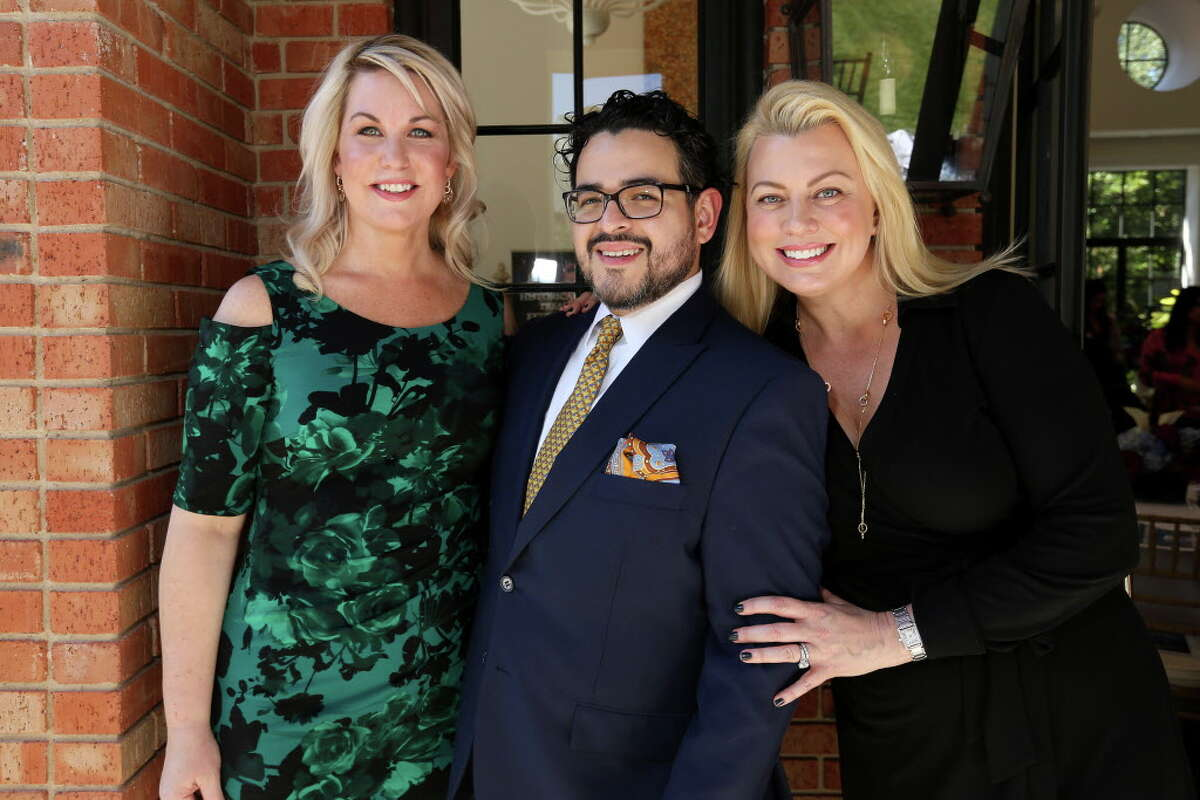 Stephanie von Stein, left, Mario Gudmundsson and Debbie Pakzaban participate the kick-off party for Joanne King Herring's