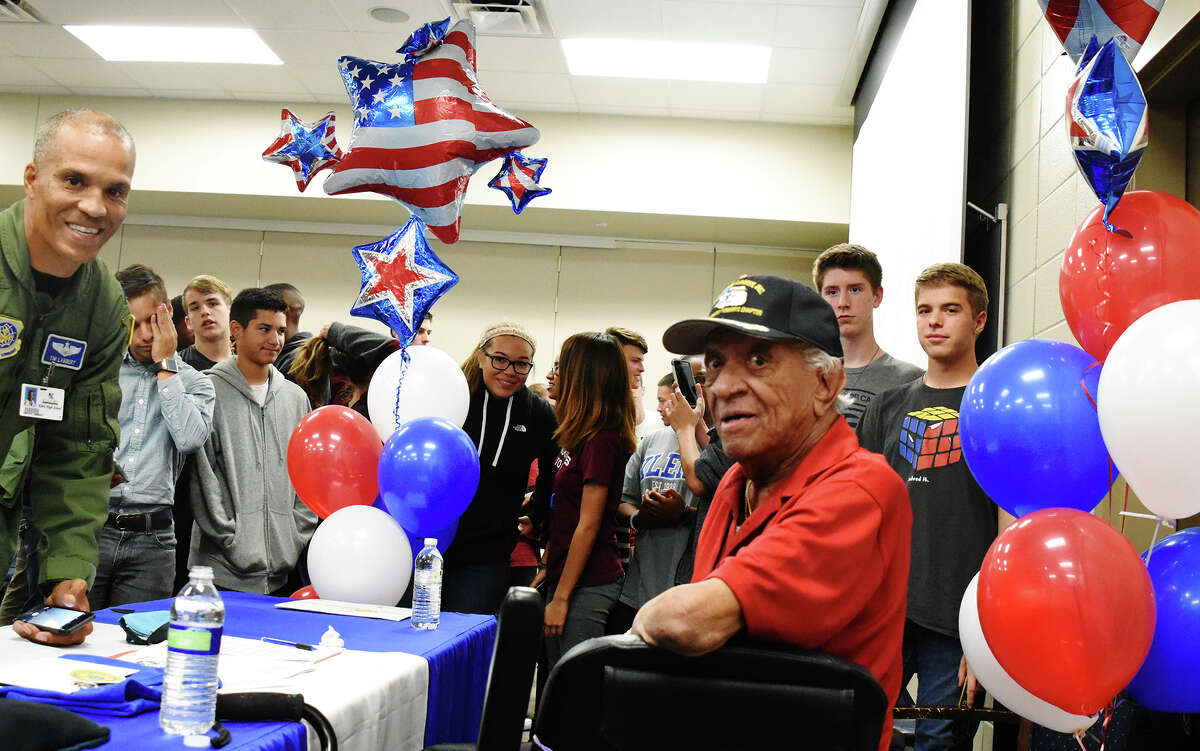 Lt. Col. Tim Lambert, left, introduced Tuskegee Airman Larry Brown to Klein High School students. Tuskegee Airman Larry Brown visited Klein High School Wednesday afternoon and visited with students about being a African American pilot in 1940 during World War II