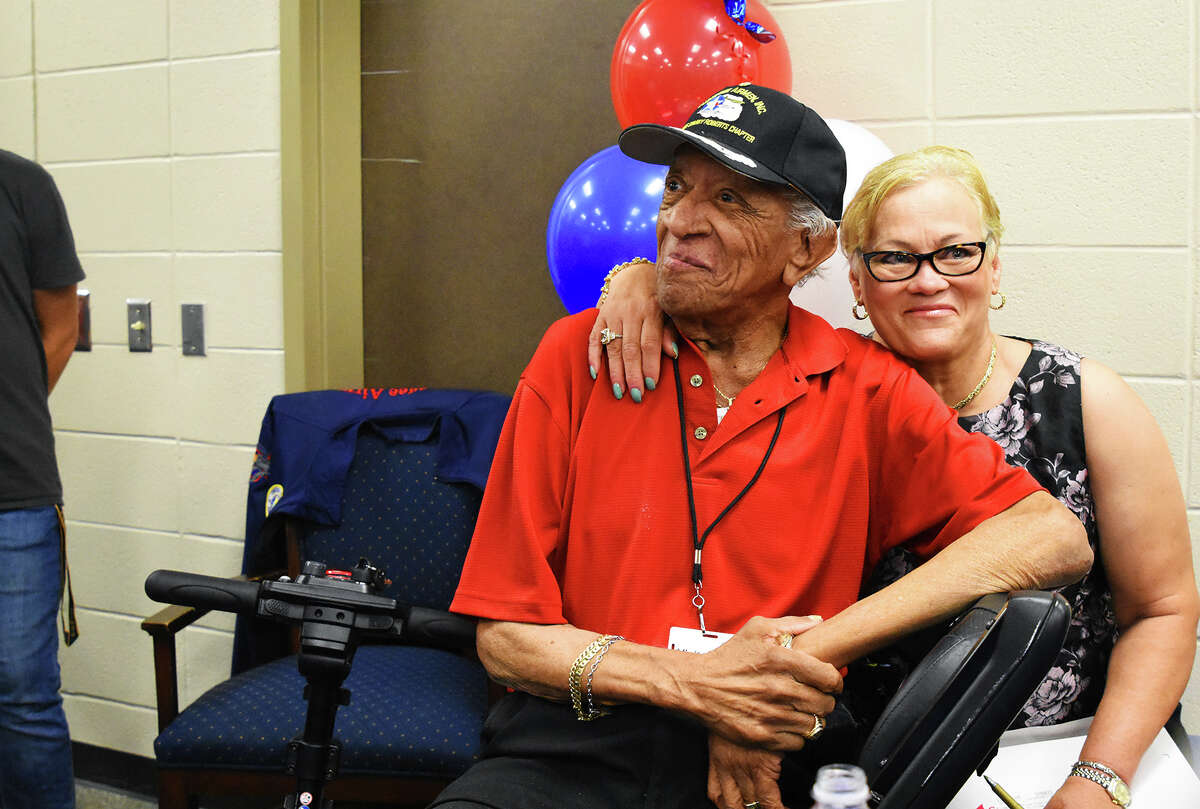Tuskegee Airman Larry Brown and wife Delores Brown greets the students at Klein High School. Tuskegee Airman Larry Brown visited Klein High School Wednesday afternoon and visited with students about being a African American pilot in 1940 during World War II