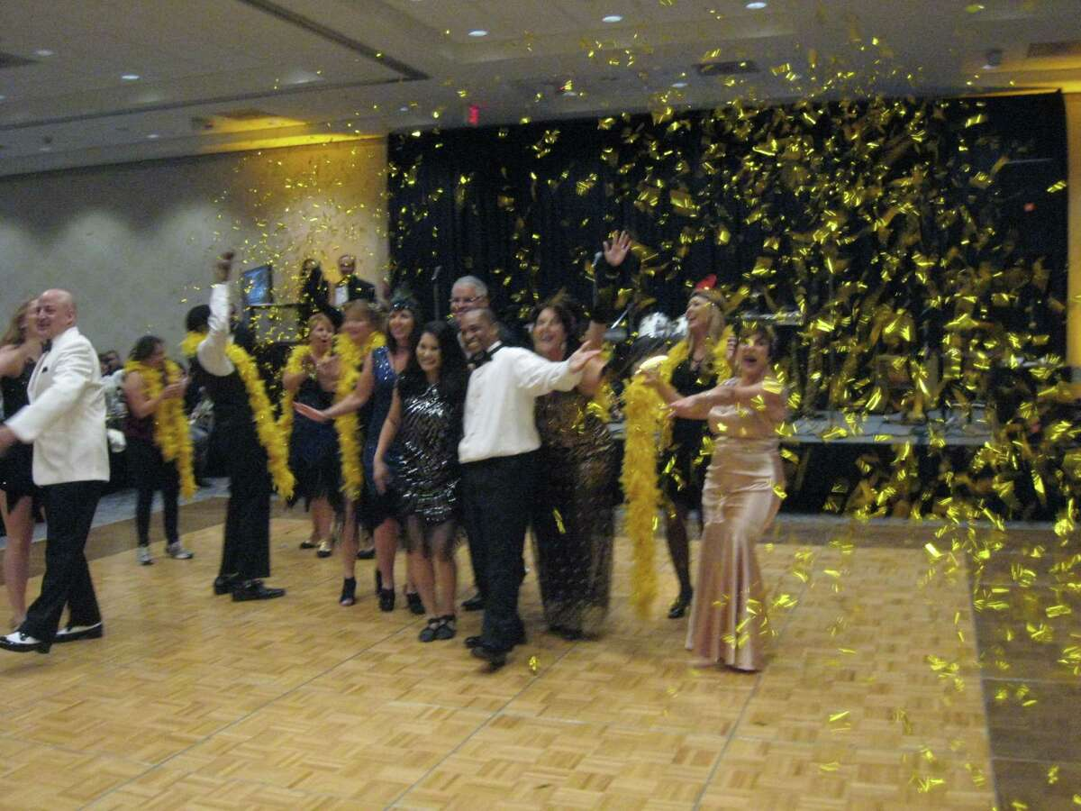 As a surprise for guests at the Village Learning Center's annual gala, a group of community representatives performed a flash mob dance Saturday, Nov. 12.