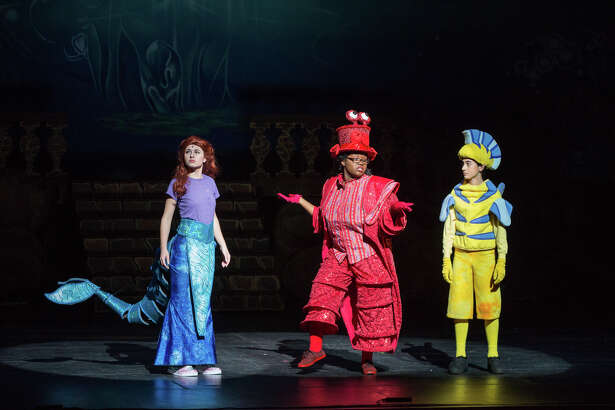Madison Brenchak (Seymour) as Ariel, Judith Suffrard (New Haven) as Sebastian and Ryan Solarzano (North Haven/North Haven High School) as Flounder in Sacred Heart's Production of The Little Mermaid.