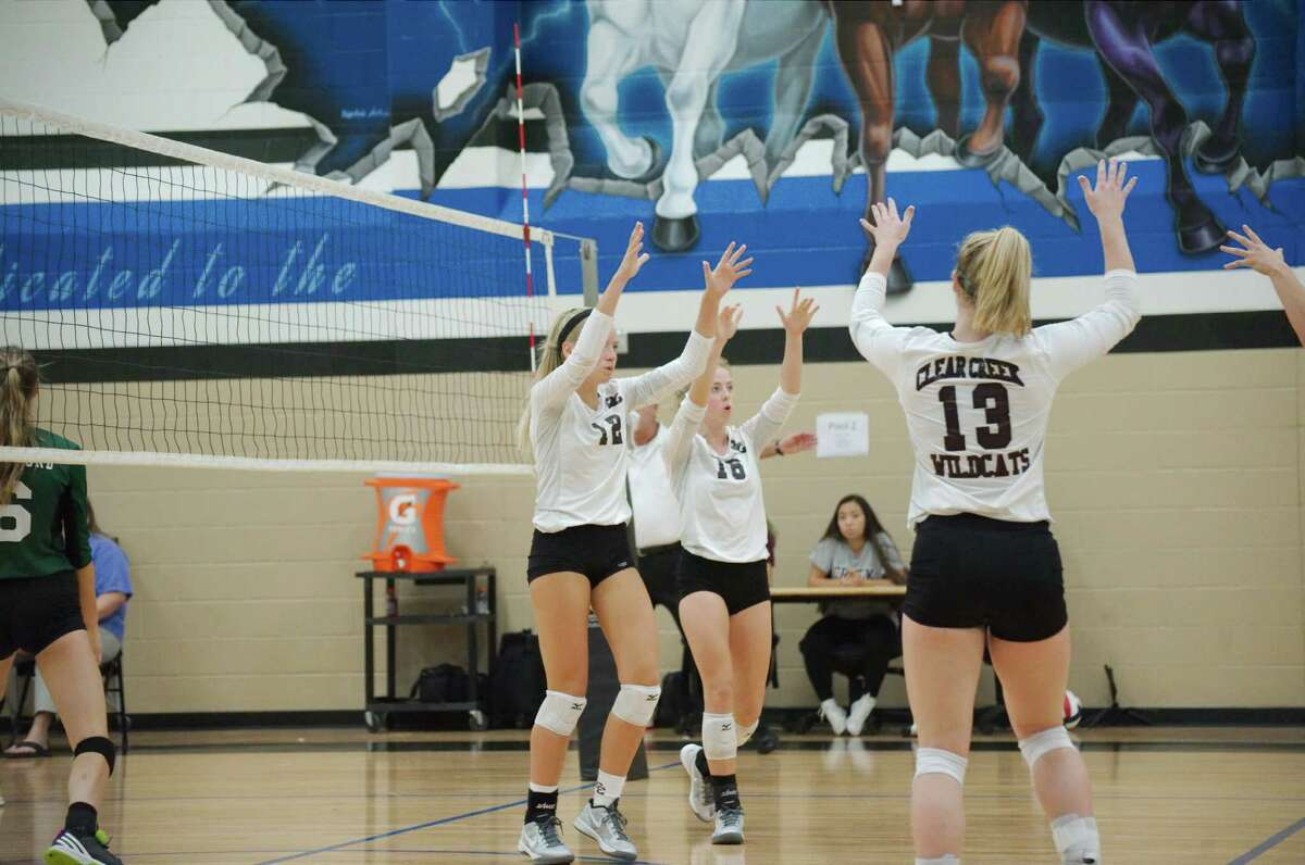 Clear Creek's Hannah Froeschl (from left), Kelsey Childers and Caitlyn Burroway celebrate a point in tournament action earlier this season. Creek plays in a Class 6A state volleyball semifinal Friday against San Antonio Reagan.