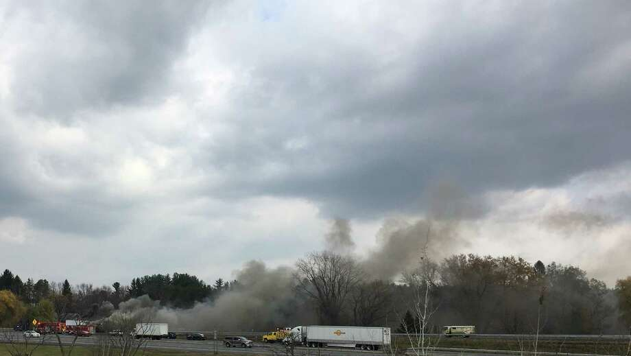 A tractor trailer caught fire on the Thruway late Thursday morning, sending a plume of smoke into the air over Bethlehem. The truck was on the northbound ramp near the entrance to the Bershire Spur of Interstate 90. (Will Waldron / Times Union)