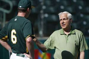 A's owner Lew Wolff talks with A's manager Bob Melvin as he makes a visit to morning workouts while the Oakland Athletics prepare to take on the Milwaukee Brewers in spring training game action at Phoenix  Stadium, in Phoenix, Arizona on Thursday Feb. 27, 2014.