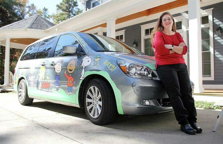 Joey Halloway poses for a portrait with her Peanuts-decorated 2007 Honda Odyssey.