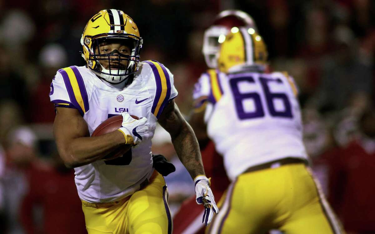 LSU's Derrius Guice (5) rushes the ball during the second half of an NCAA college football game against Arkansas, Saturday, Nov. 12, 2016, in Fayetteville, Ark. (AP Photo/Samantha Baker)