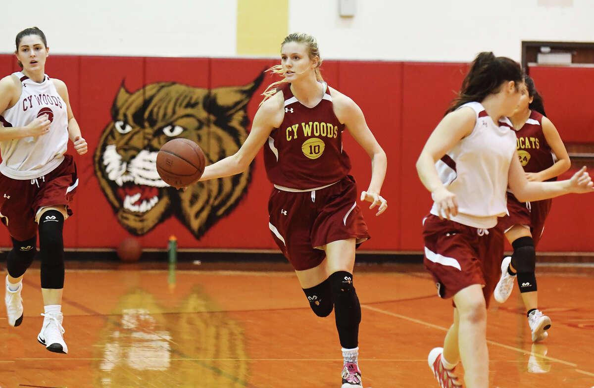 Cy Woods senior forward/post Cate Reese runs the fast break in practice earlier this week. Reese projects to be an impact player for Cy Woods on both sides of the court, much as she was for the volleyball team earlier this year.