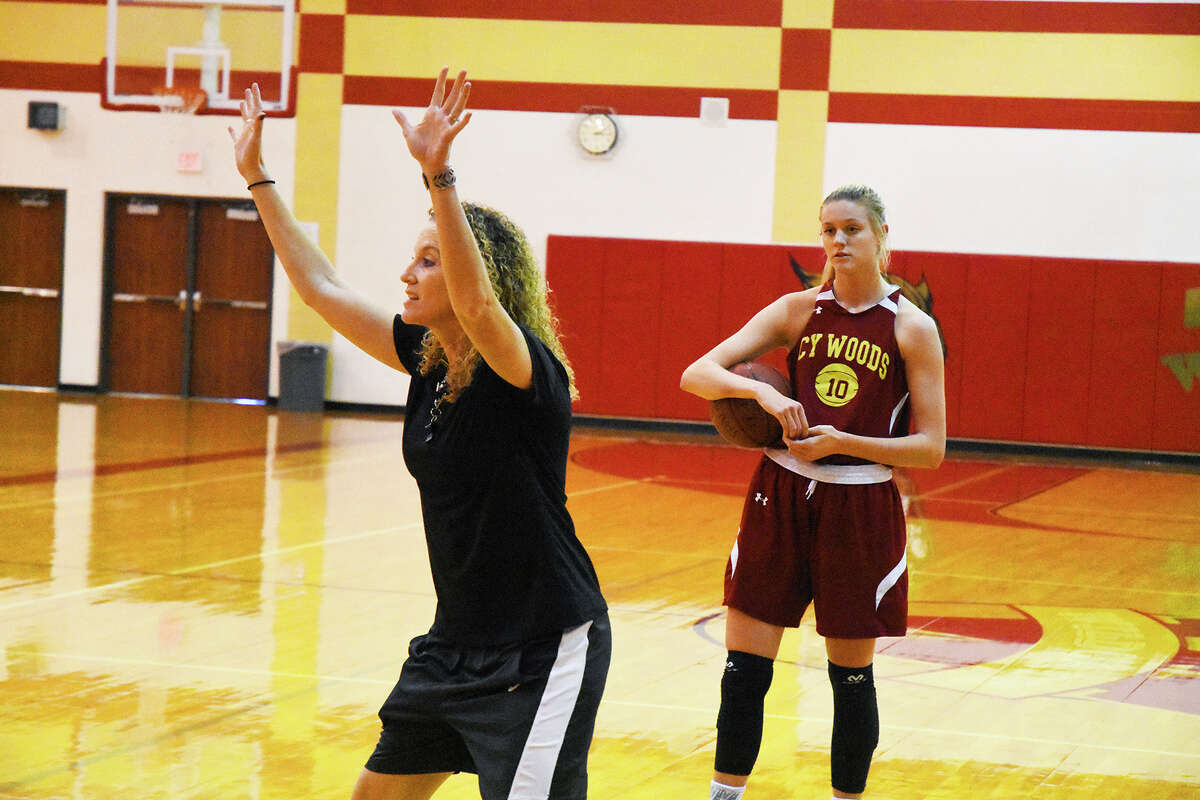 Cy Woods head coach Virginia Flores offers some guidance in practice. Under Flores, the team has won two consecutive district titles and, two years ago, a state title, and looks to be poised for another dominant run in 17-6A this year.