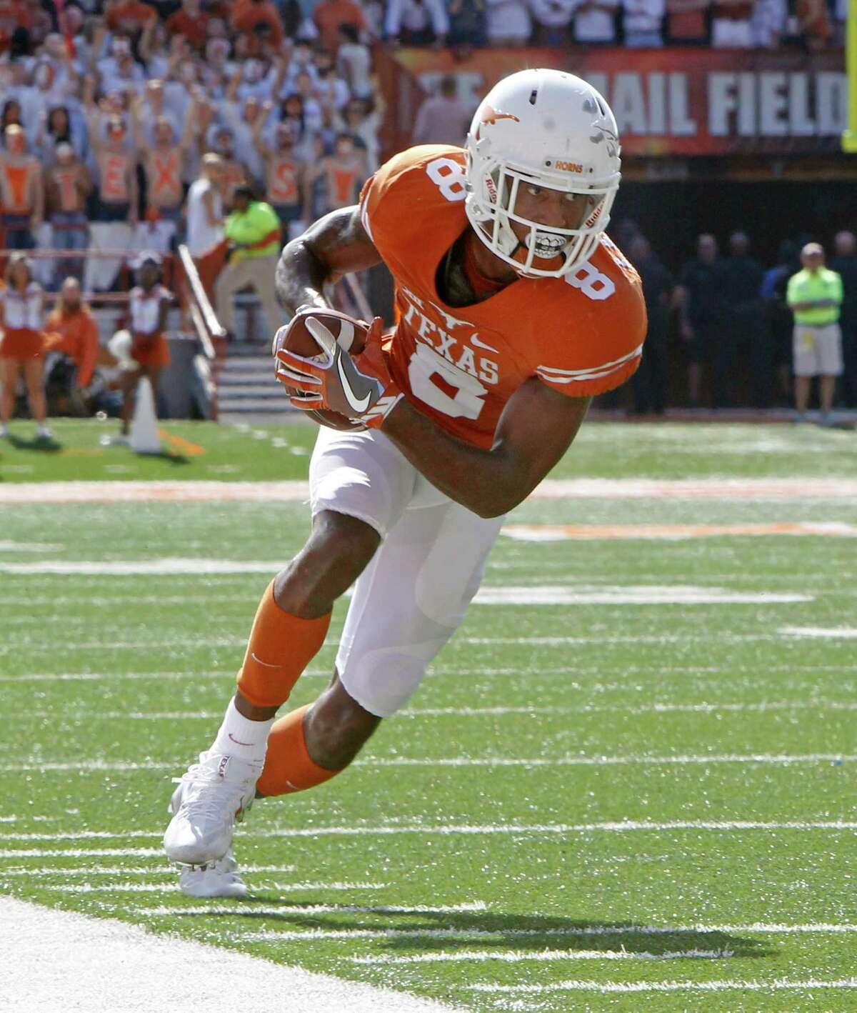 Texas receiver Dorian Leonard runs with a pass during the first half of an NCAA college football game against West Virginia, Saturday, Nov. 12, 2016, in Austin, Texas. (AP Photo/Michael Thomas)