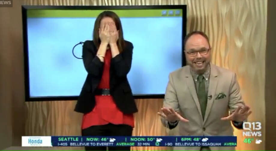 Q13 News This Morning anchor Kaci Aitchison reacts after accidentally making bathroom art during Wednesday's broadcast. Q13 digital director Travis Mayfield gets a little giddy. Photo: Q13 Screen Grab