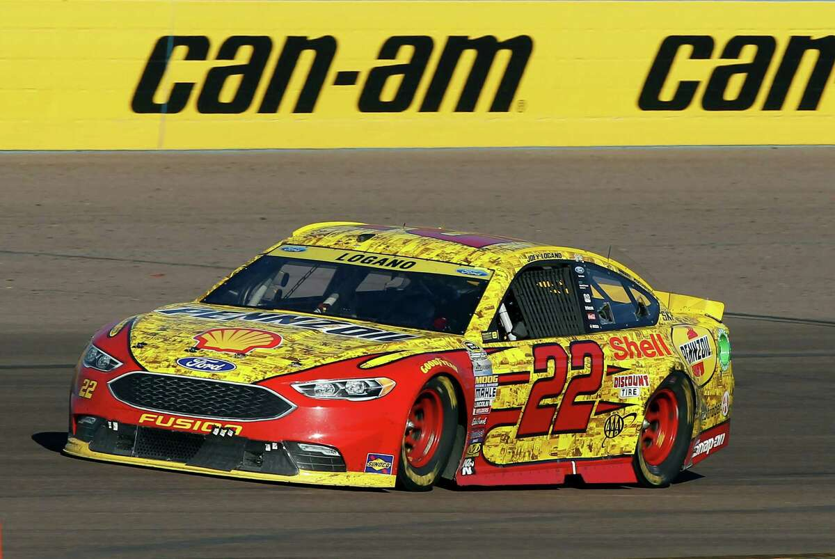 Joey Logano drives out of Turn 4 during the NASCAR Sprint Cup Series auto race at Phoenix International Raceway, Sunday, Nov. 13, 2016, in Avondale, Ariz. (AP Photo/Ralph Freso)