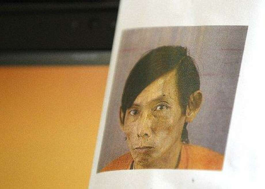 A photograph of the late homeless Tai Lam, 67, who was beaten to death last Monday is shown during a press conference at the Hall of Justice Dec. 2, 2014 in San Francisco, Calif. Photo: Leah Millis / The Chronicle / /