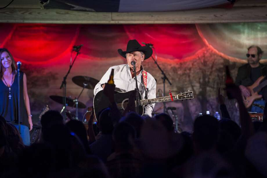 """Taking the stage just after 7 p.m., The King of Country Music with his band, The Ace in the Hole Band, kicked off the surprise performance with """"Here For A Good Time,"""" a song Strait co-wrote with his son, Bubba Strait, and Dean Dillon. Photo: Erika Goldring For MCA Nashville"""