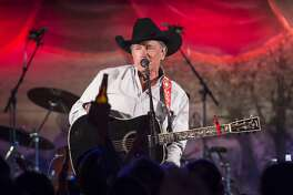 """Taking the stage just after 7 p.m., The King of Country Music with his band, The Ace in the Hole Band, kicked off the surprise performance with """"Here For A Good Time,"""" a song Strait co-wrote with his son, Bubba Strait, and Dean Dillon."""