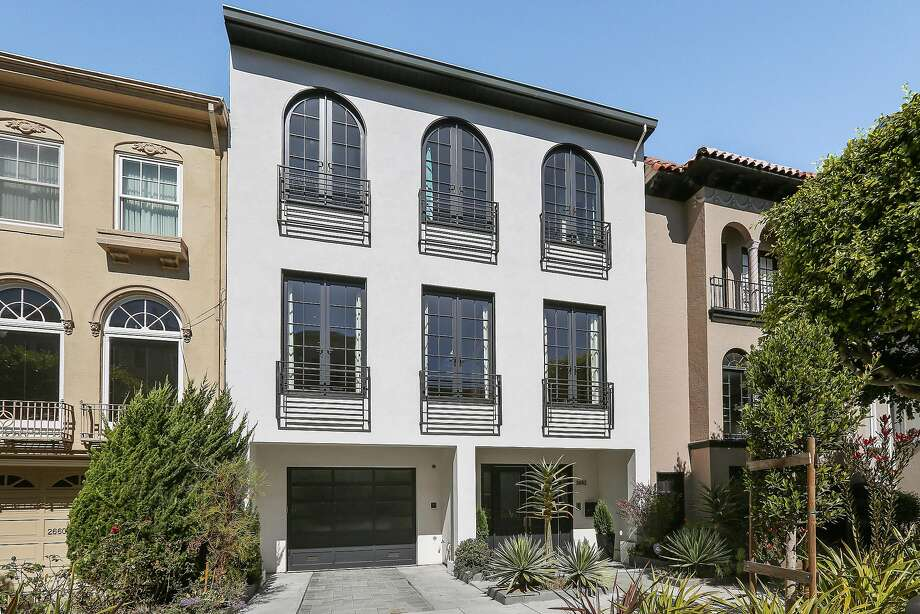 2652 Chestnut St. in Cow Hollow was built in 2014 and features a symmetrical facade with arched windows. Photo: Open Homes Photography