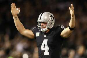 OAKLAND, CA - NOVEMBER 06:   Derek Carr #4 of the Oakland Raiders celebrates a touchdown during the second quarter against the Denver Broncos at Oakland-Alameda County Coliseum on November 6, 2016 in Oakland, California. (Photo by Ezra Shaw/Getty Images)