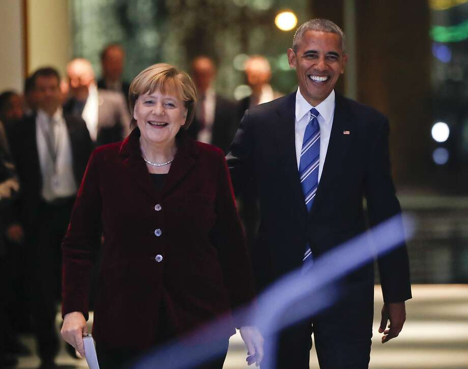 German Chancellor Angela Merkel and President Obama smile as they arrive for their joint news conference at the German Chancellery in Berlin. Photo: Pablo Martinez Monsivais, Associated Press