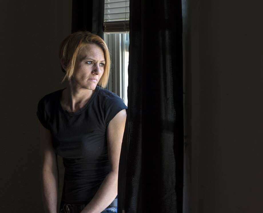 "Rachelle Allen, who became hooked on opioid prescription drugs after being prescribed Vicodin by her doctor after surgery, has called the last 10 years ""addiction hell."" Rachelle Allen in her downtown Kansas City apartment on Wednesday, Jan. 27, 2016. (Allison Long/Kansas City Star/TNS) Photo: Allison Long/Kansas City Star"