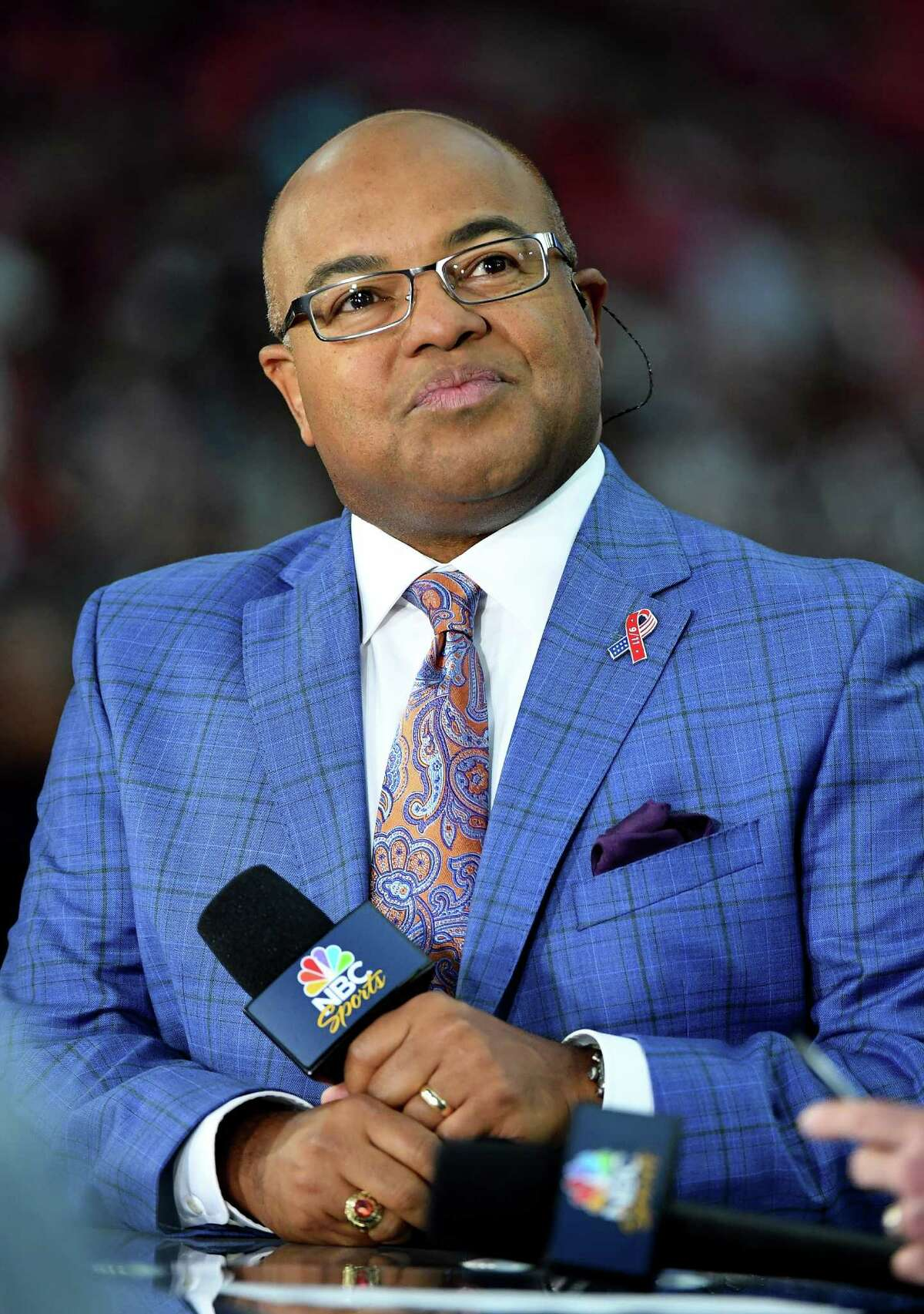 Sportscaster Mike Tirico sits on the Sunday Night Football set before the NFL game between the New England Patriots and the Arizona Cardinals at University of Phoenix Stadium on September 11, 2016 in Glendale, Arizona. New England won 23-21. (Photo by Ethan Miller/Getty Images)