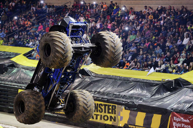 """Midnight Rider gains some air during Friday night's Monster Nation event. Monster Nation returns to Ford Arena this weekend to celebrate the 40th anniversary of the legendary Bigfoot, which is listed in the Guinness Book of World Records as the """"World's Tallest, Widest, and Heaviest Monster Truck."""" Photo taken Friday 2/20/15 Jake Daniels/The Enterprise"""