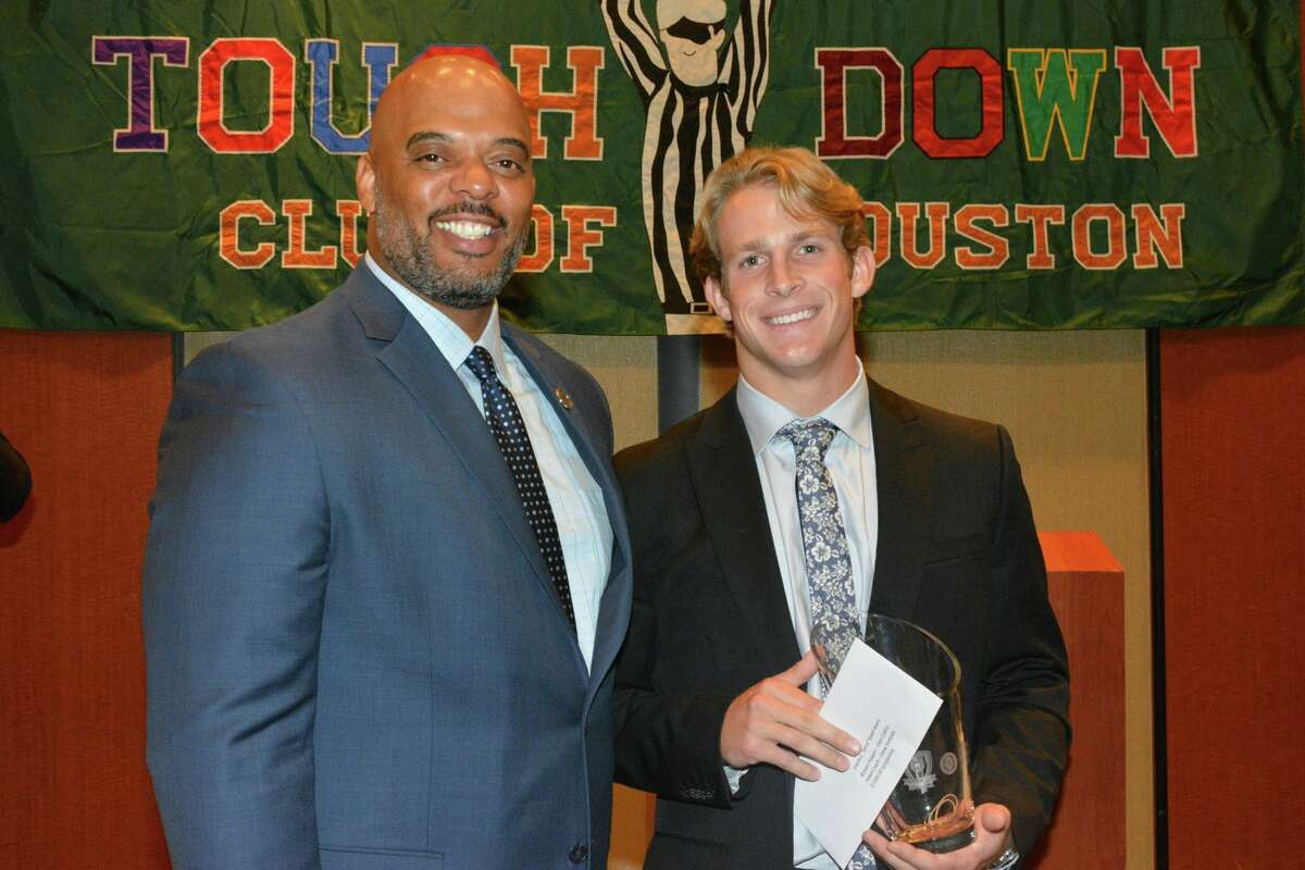 Klein Collins senior quarterback Bryson Powers (right) stands beside James Colbert, Jr. from the Harris County Department of Education after receiving the 2016 Houston Touchdown Club Scholar-Athlete of the Year Award. Powers is a uniquely qualified winner, according to head coach Drew Svoboda.