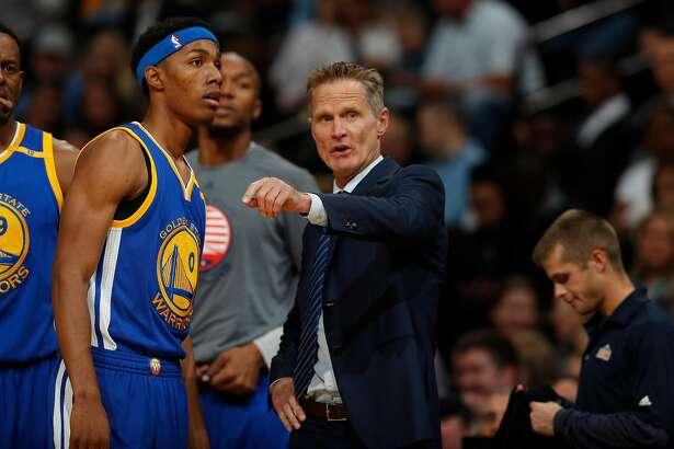 Golden State Warriors head coach Steve Kerr, right, directs Golden State Warriors guard Patrick McCaw (0) in the first half of an NBA basketball game Thursday, Nov. 10, 2016, in Denver. (AP Photo/David Zalubowski)