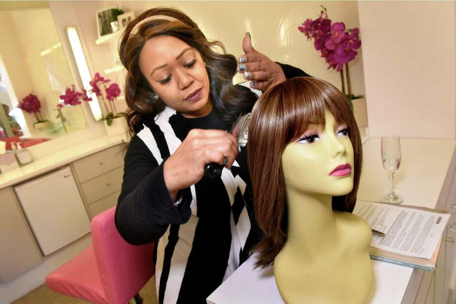 "Kimberly ""Kimora"" Fray, a cosmatelogist and wig specialist, styles a wig for Kathy Marin of Valatie on Tuesday, Nov 8, 2016, at Rumors Salon and Spa in Latham, N.Y. (Cindy Schultz / Times Union) Photo: Cindy Schultz / Albany Times Union"